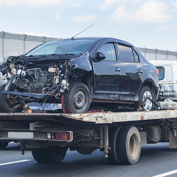 truck carrying the damaged car